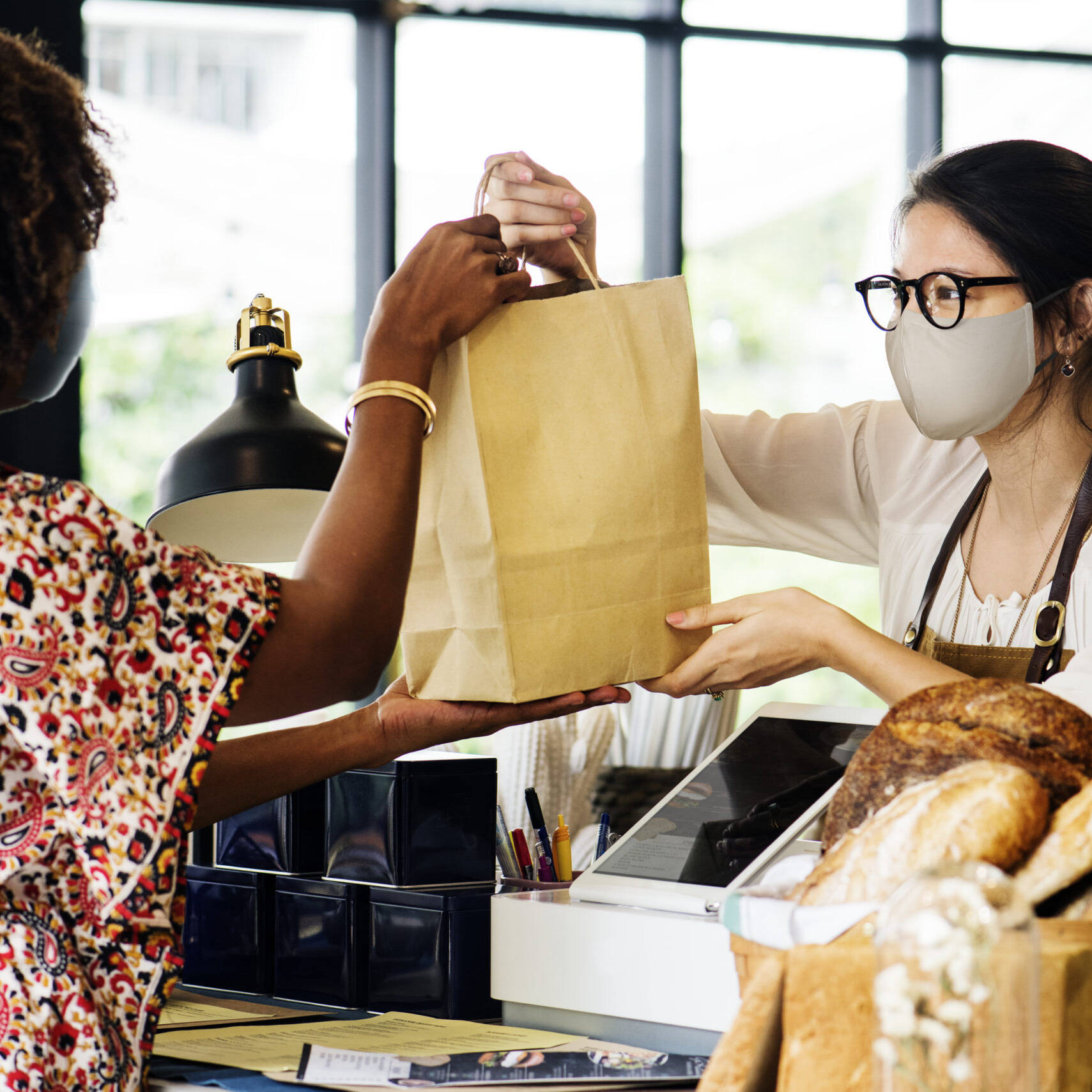 Virginia SBDC Capital Region | Small business owner with mask helping customer